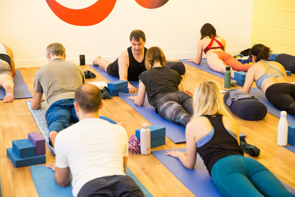 yoga class with people lying on their front