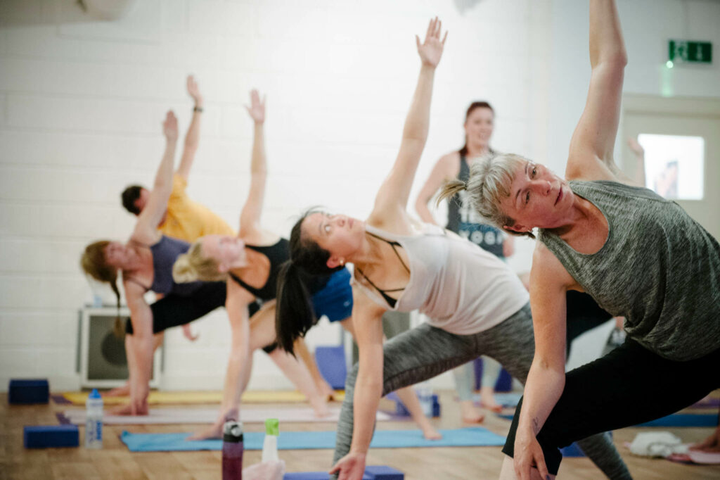 students practicing hot yoga with determination