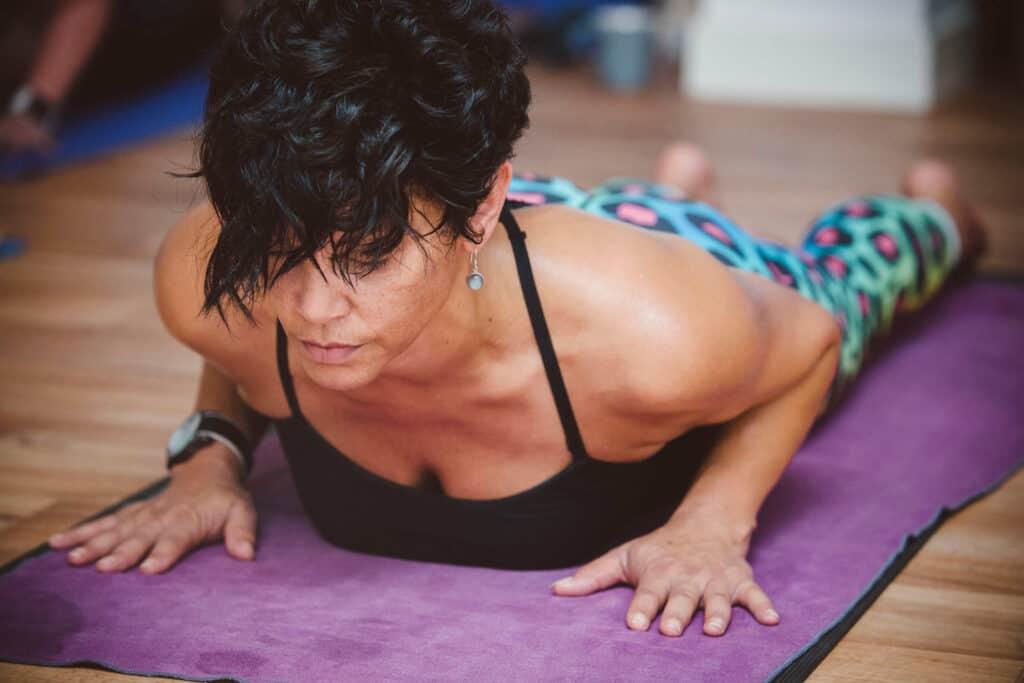 Female yoga student doing cobra backbend