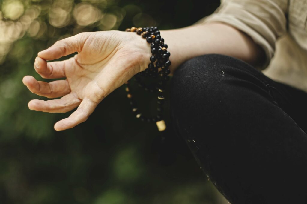Mudra practice of touching thumb and index finger tips together