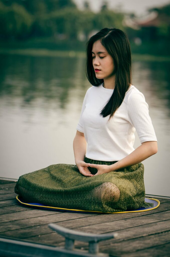Woman meditating in peaceful setting