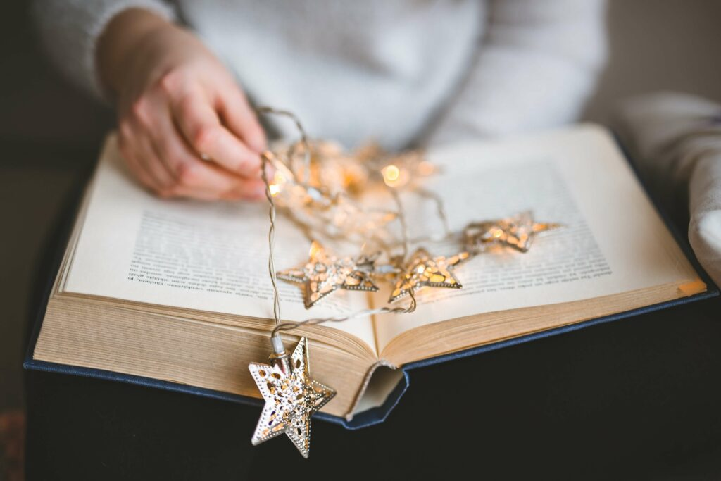 enlightening texts for yoga book with fairy lights