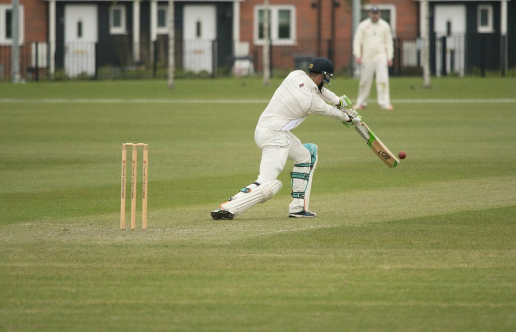 Cricketer batting a ball low down