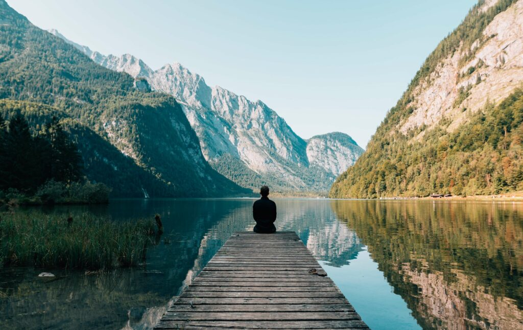Meditation on the end of a pontoon leading out to a mountain lake