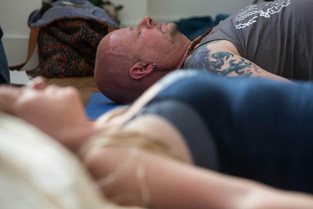 People lying down in a yoga class