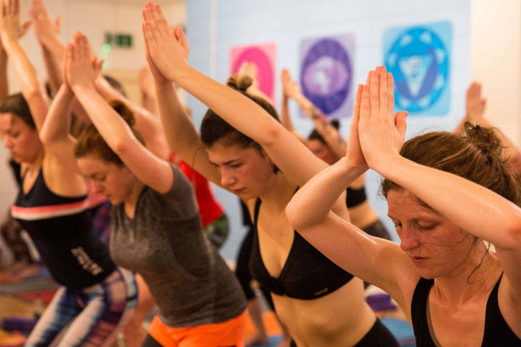 Students at a hot yoga class at Yogafurie