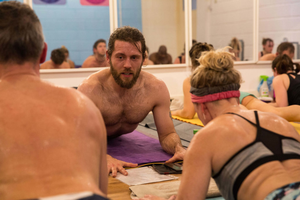 Aaron teaching a hot yoga class at Yogafurie