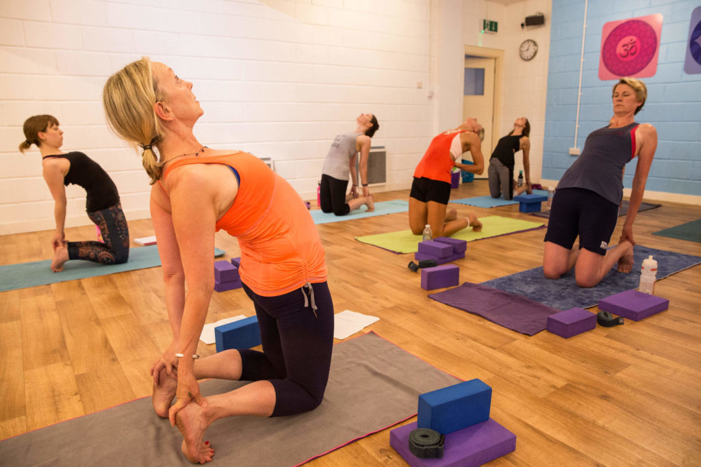 Sian centre right in this picture leaning her way into a back bend during a hot yoga class at Yogafurie