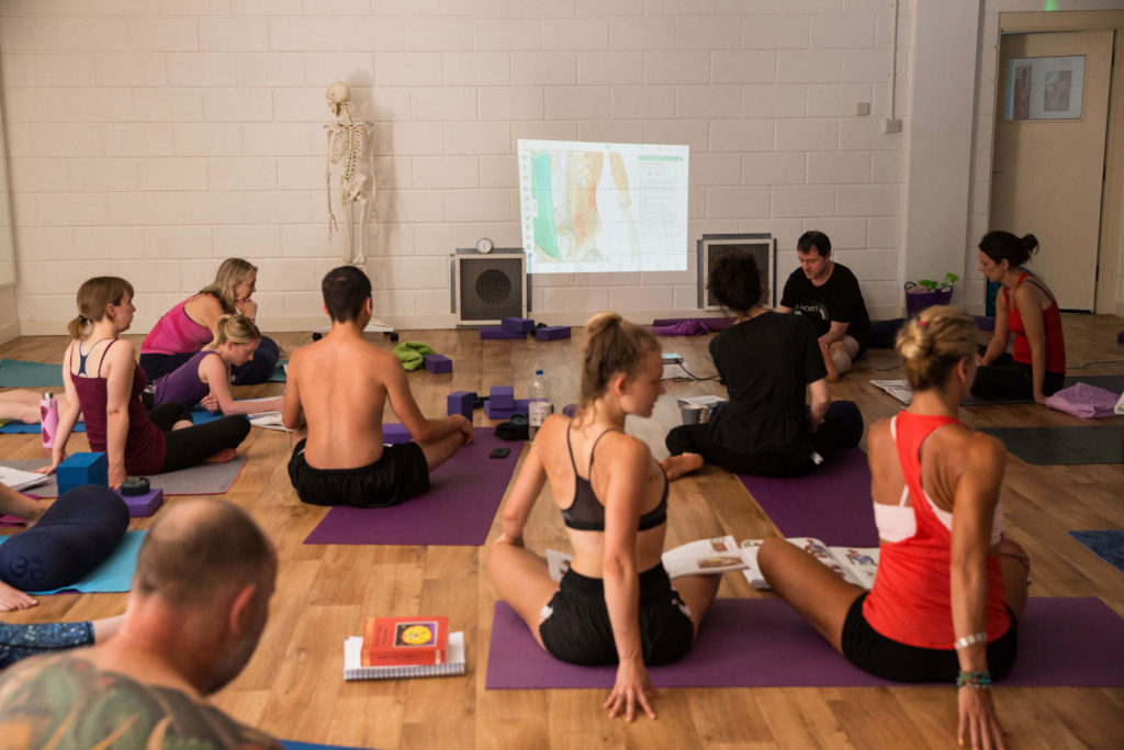 Yogafurie Teacher Trainees learning about easy seated twist during a training weekend