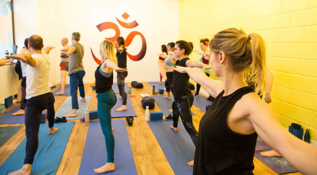 Teacher trainees practising asana