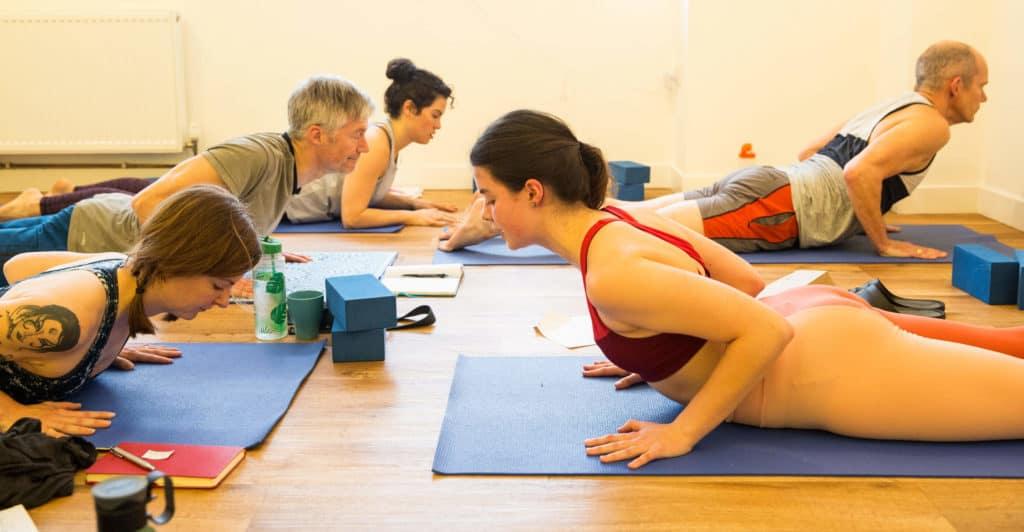 Yogafurie Teacher Trainee teaching a lesson to their colleagues