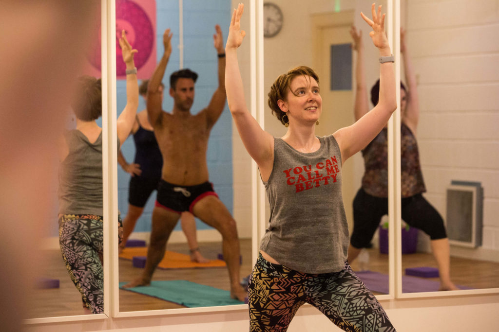Teacher Training Graduate Kate S teaching a public class at Yogafurie