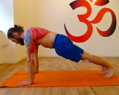 Yogafurie Teacher Aaron demonstrating chatturanga (lifted plank) with the key muscles drawn around his shoulders which will be used for chatturanga dandasana (low plank)