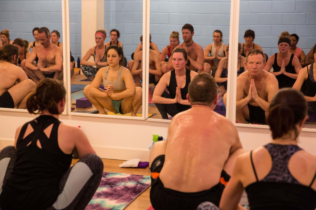 Yogafurie students practicing squat which asks for flexibility in the hip joints
