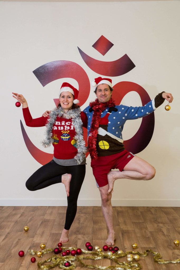 Ed and Sinead support each other in Christmas tree pose for yoga partners