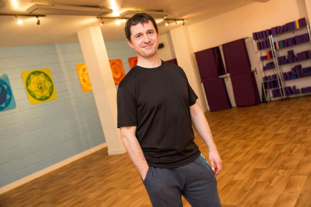 Lead Instructor Ed in Yogafurie's hot yoga studio