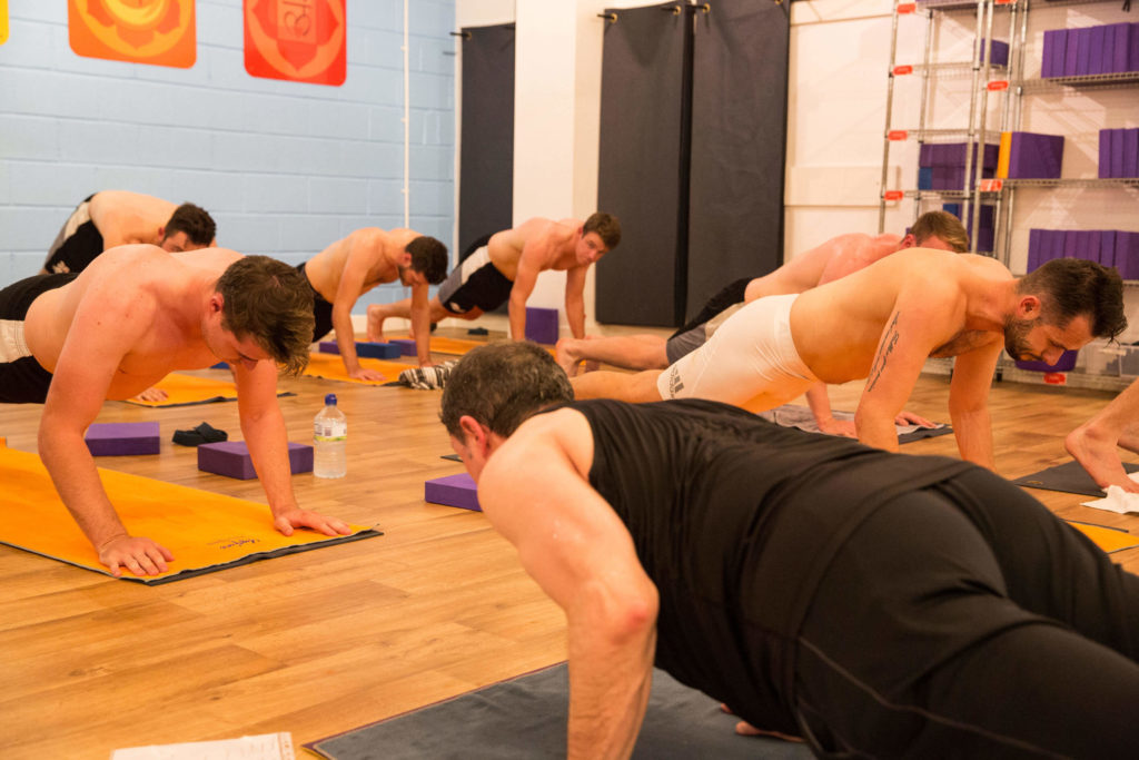 Lead Instructor Ed teaches an all-male group at Yogafurie