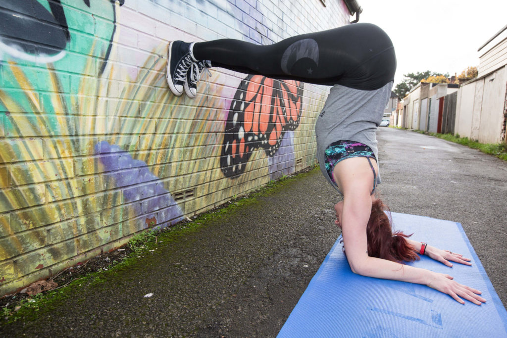 Sinead doing a preparatory pose for forearm stand