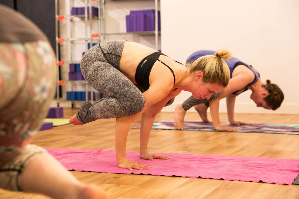 Using your intention in a hot yoga class to achieve an arm balance