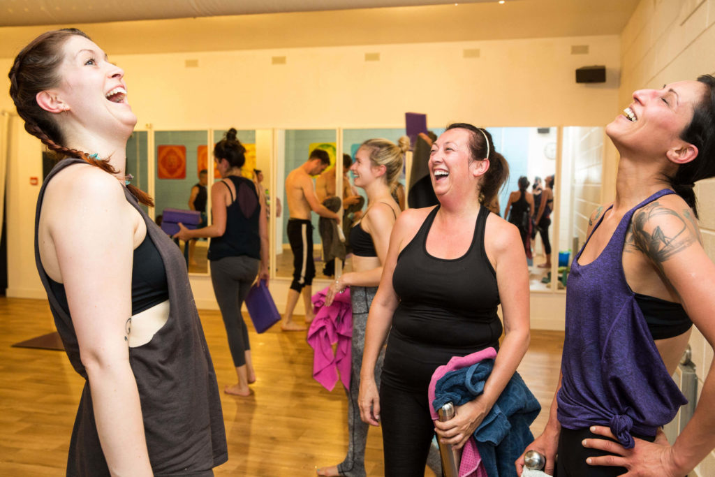Yogafurie students with teacher Sinead catching up and laughing together after a hot yoga class
