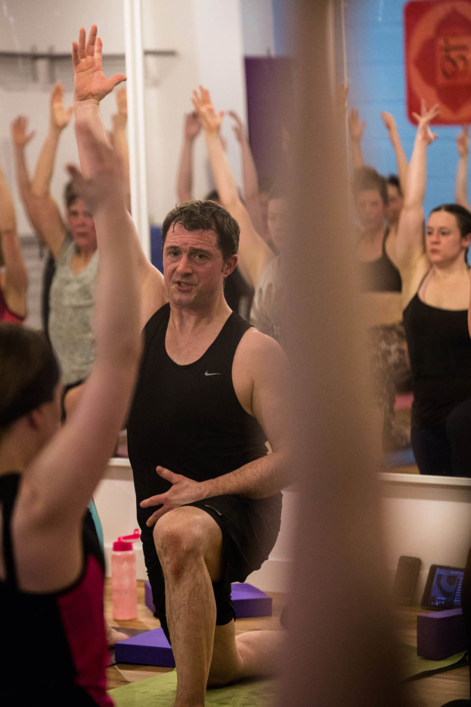 Ed teaching in the hot yoga studio at Yogafurie