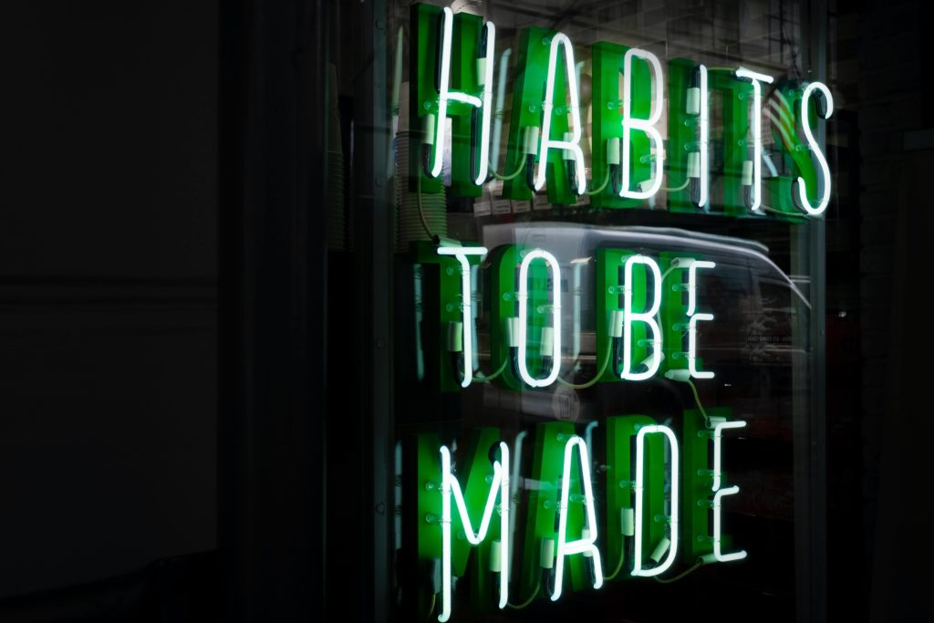 Neon light showing habits to be made