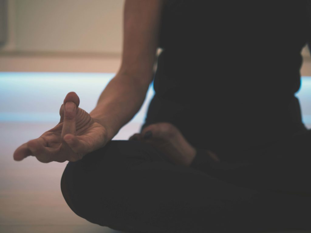 Seated meditation using a mudra or hand position which is believed to alter the flow of energy