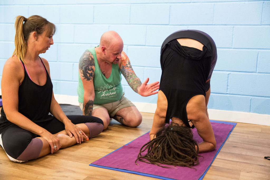 Yogafurie Teacher Trainees learning how to build up to headstand