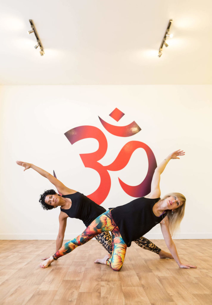 Yogafurie students show side plank pose with the knee down