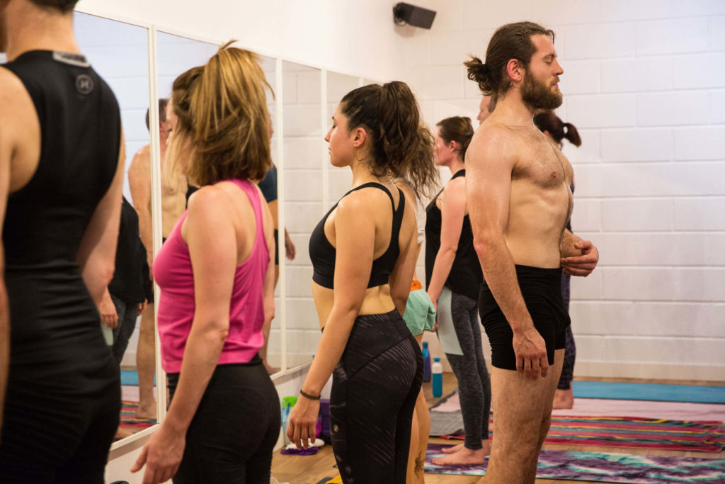 A breathing exercise during a Yogafurie hot yoga class