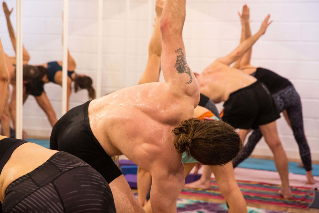 A hot yoga class at Yogafurie where you can expect to get hot enough to sweat