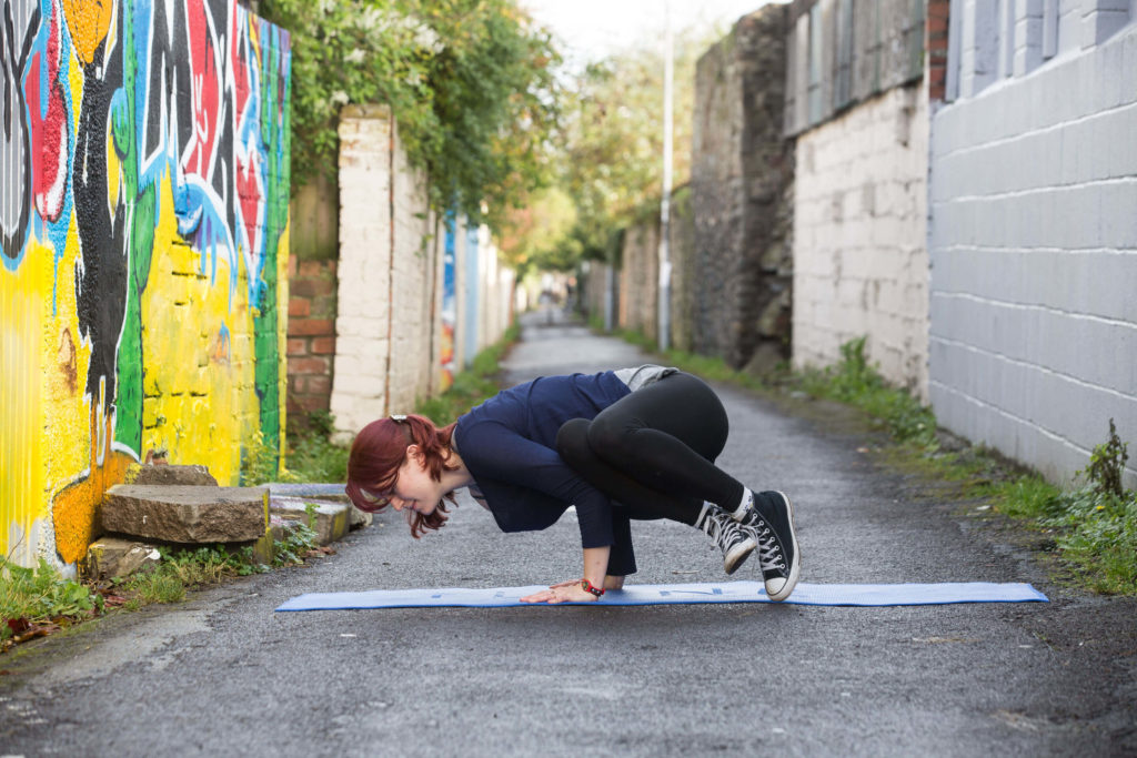 Sinead leans forward slowly until her feet slowly lift from the ground