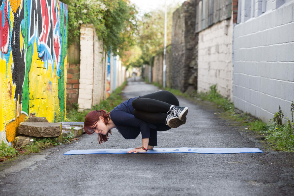 Sinead demonstrates side crow in Happy Lane in Bristol