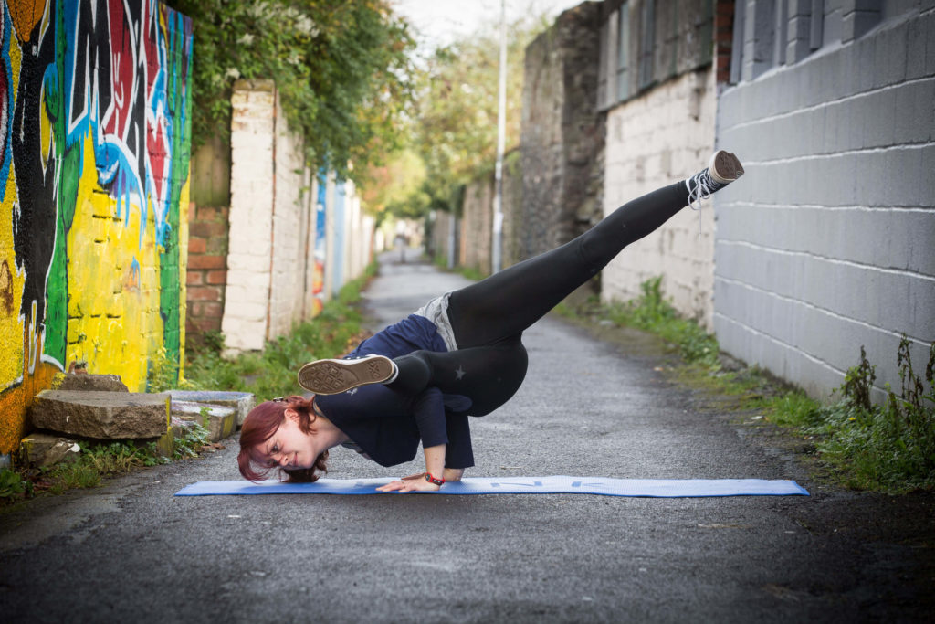 Sinead in 'Split Leg' Side Crow pose, photographed at Happy Lane.