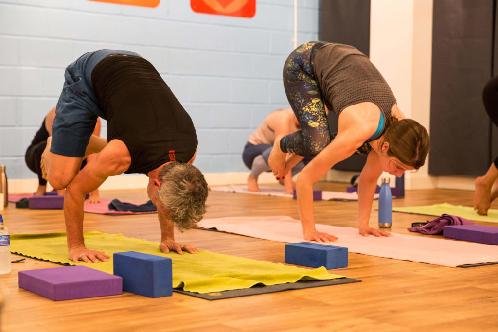 Yogafurie students show crow pose