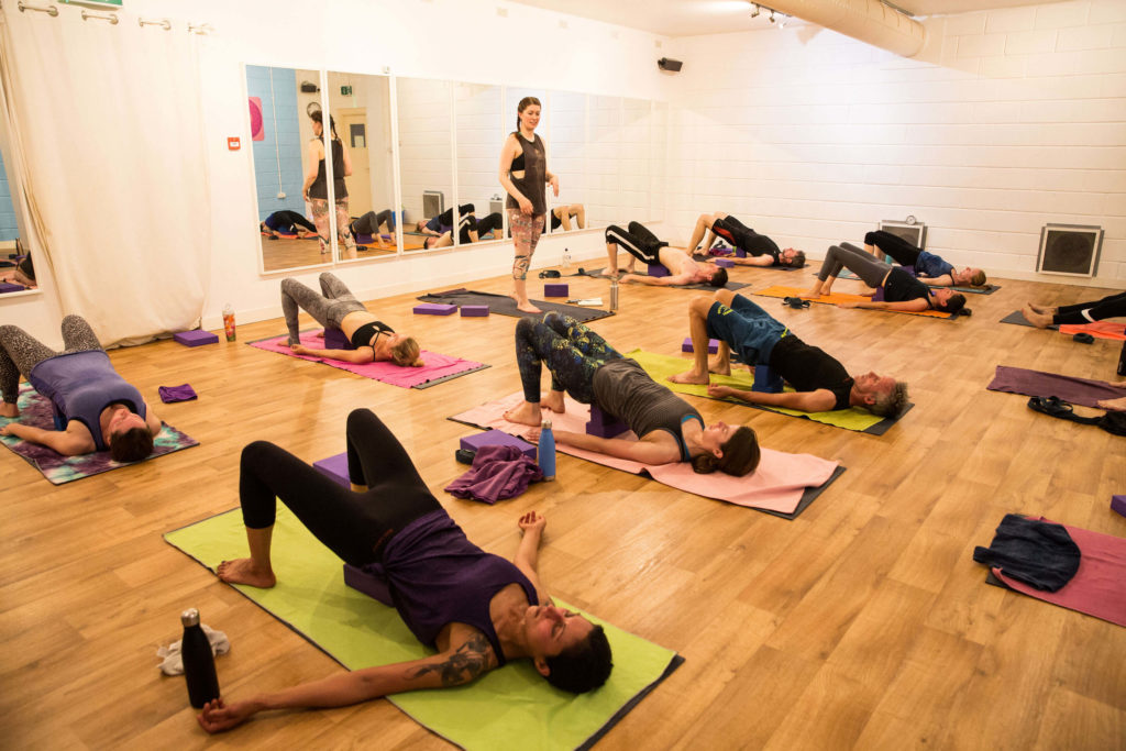 Sinead teaches bridge pose to students which you can do with supports under your lower back and pelvis