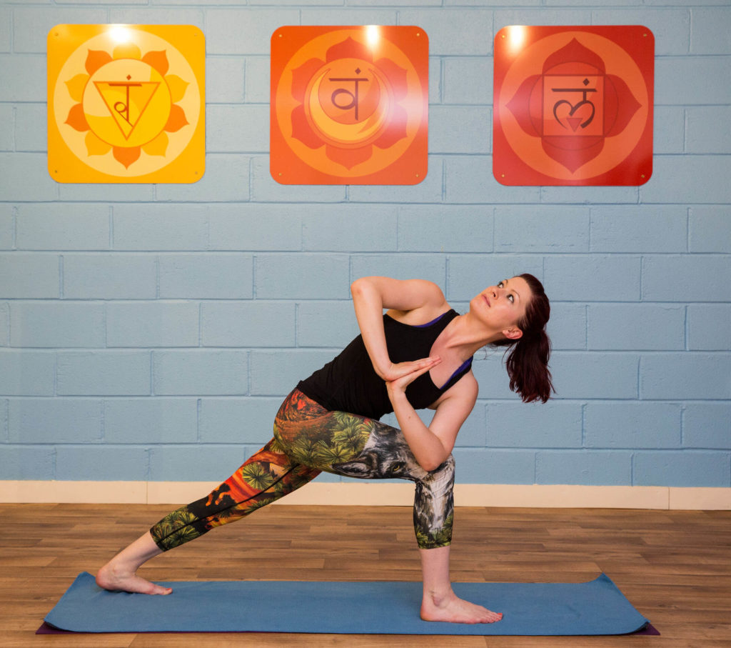Sinead demonstrates revolved side angle pose