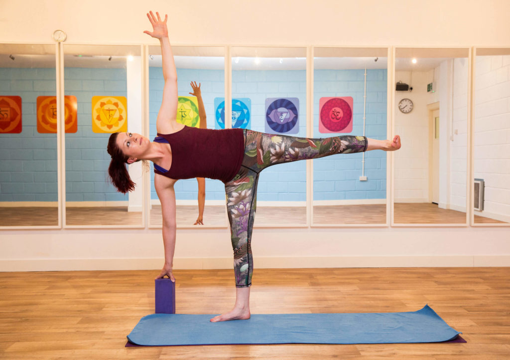 Sinead demonstrating Ardha Chandrasana with brick under right hand.