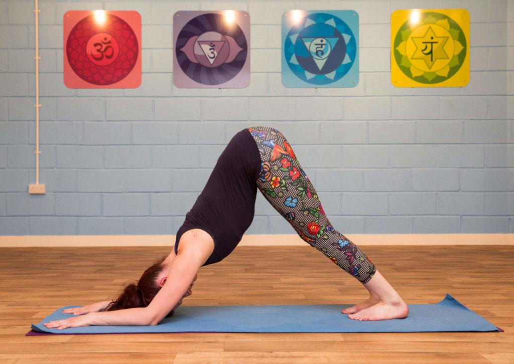 Sinead demonstrating dolphin position as the starting point to achieving headstand
