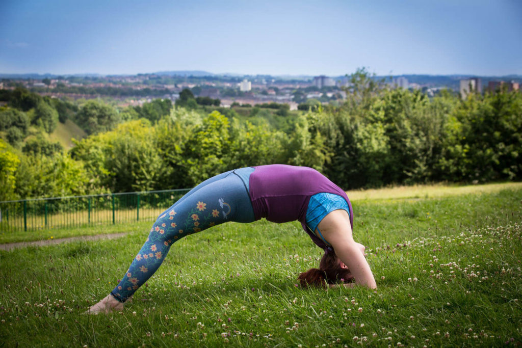 Sinead demonstrates urdhva dhanurasana with the elbows down