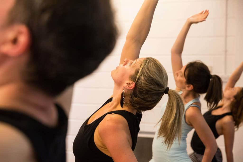 Teacher Trainees in class in Reverse Warrior pose.