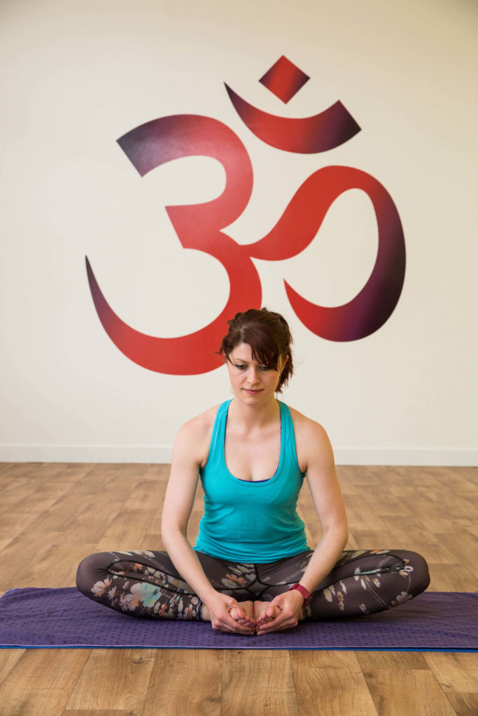 Baddha Konasana can help prepare your hips for Cow Face Pose.