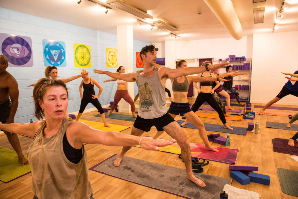 Warrior 2 during a Yogafurie hot yoga class