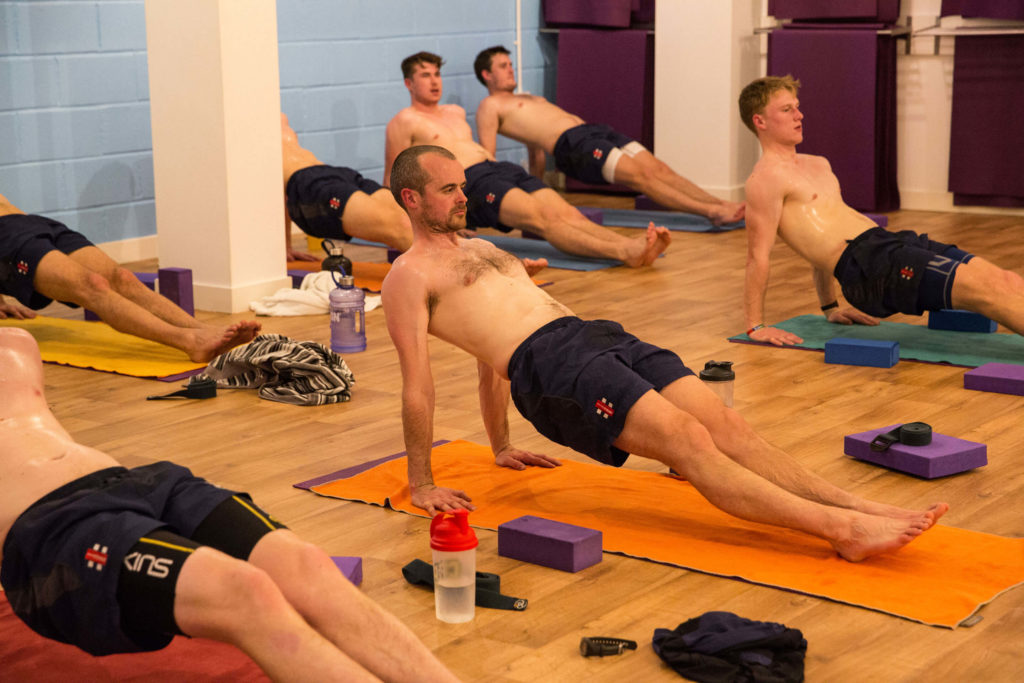 A group of professional sportsmen using Yogafurie's hot yoga to prepare for the season ahead