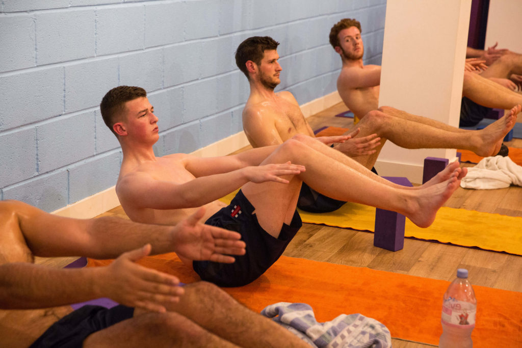 Gloucestershire cricketers using boat pose to activate their cores