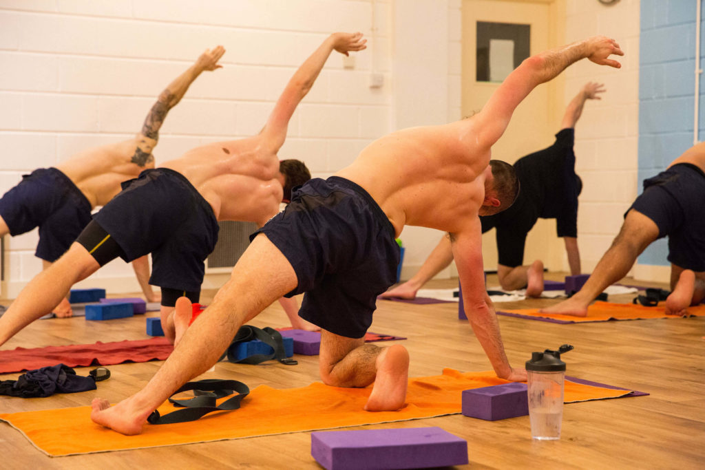 Cricket club class in Side Plank with one knee on the floor.