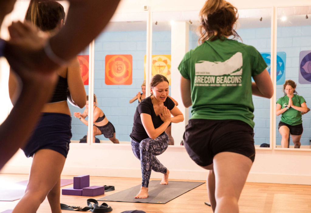 Teacher Trainees twisting from lunge to Parivrtta Parsvakonasana (Step Three).