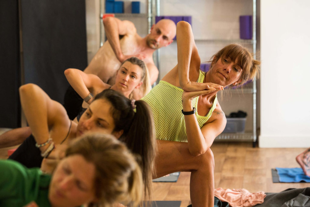 Teacher Trainees in final Parivrtta Parsvakonasana pose, gazing to the side (Step Six).