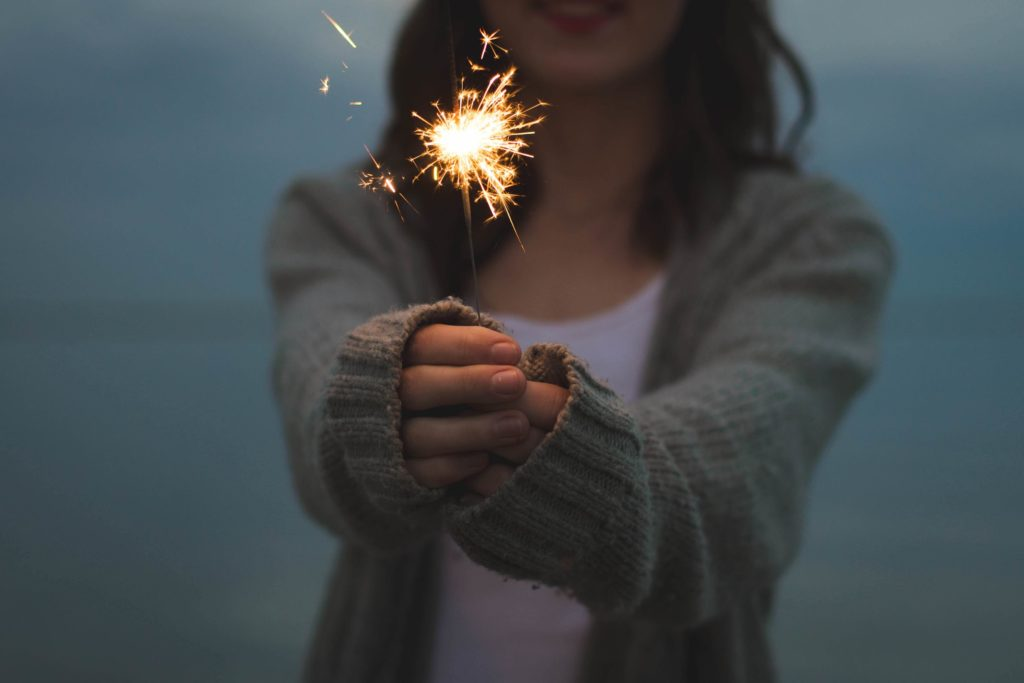 Woman holds a sparkler