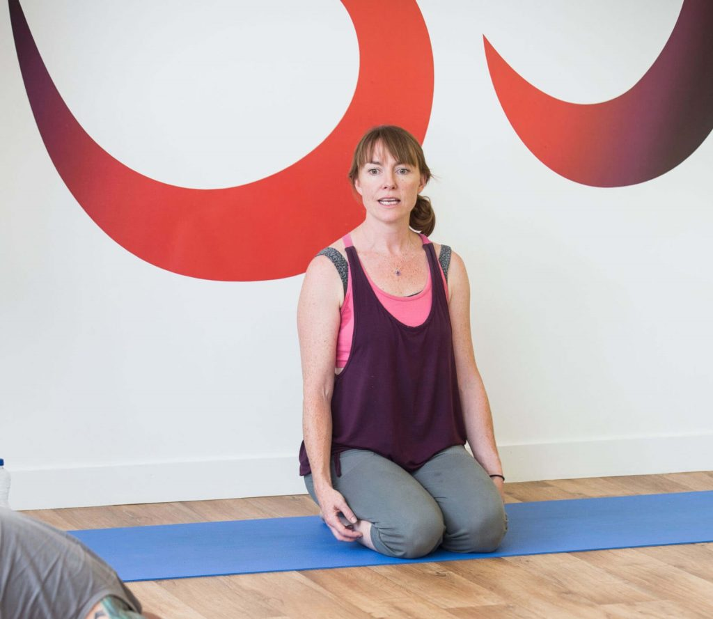Yogafurie teacher Morven sat in the kneeling position before you begin the breathing exercise